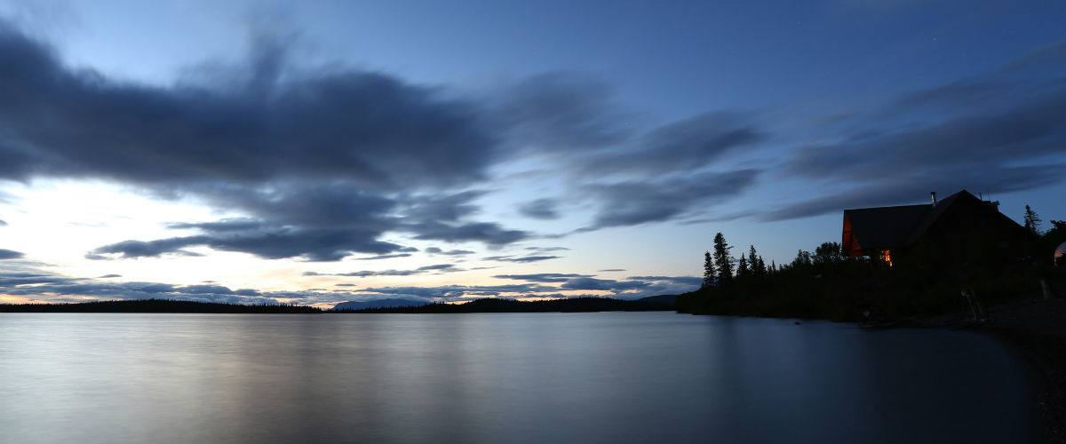 Beautiful view of Intricate Bay Lodge on Lake Iliamna in the evening