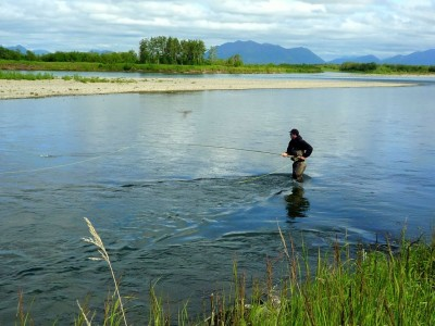 Fly fishing on a lonely river in Alaska